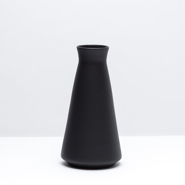The porcelain wine decanter in dusty black, our black glaze. Modern, handmade pottery, made in Detroit, Michigan.  USA Made pottery and unique gifts. Black pottery.