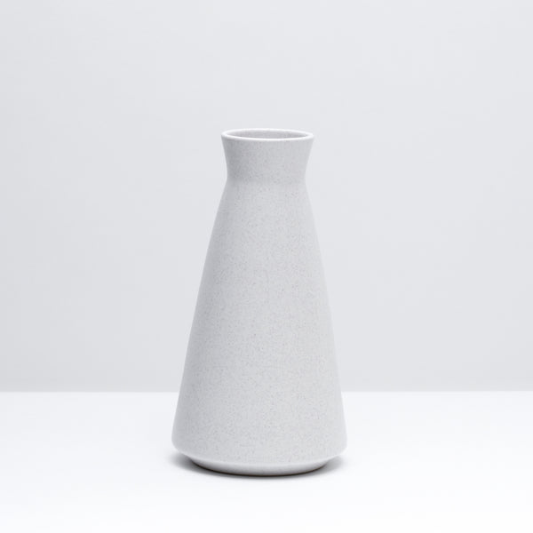 The porcelain wine decanter in freckle, our speckled white glaze. Modern, handmade pottery, made in Detroit, Michigan.  USA Made pottery and unique gifts. Speckled pottery.