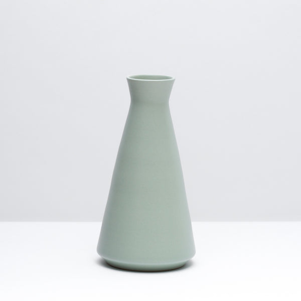 The porcelain wine decanter in mint, our green glaze. Modern, handmade pottery, made in Detroit, Michigan.  USA Made pottery and unique gifts. Green pottery.