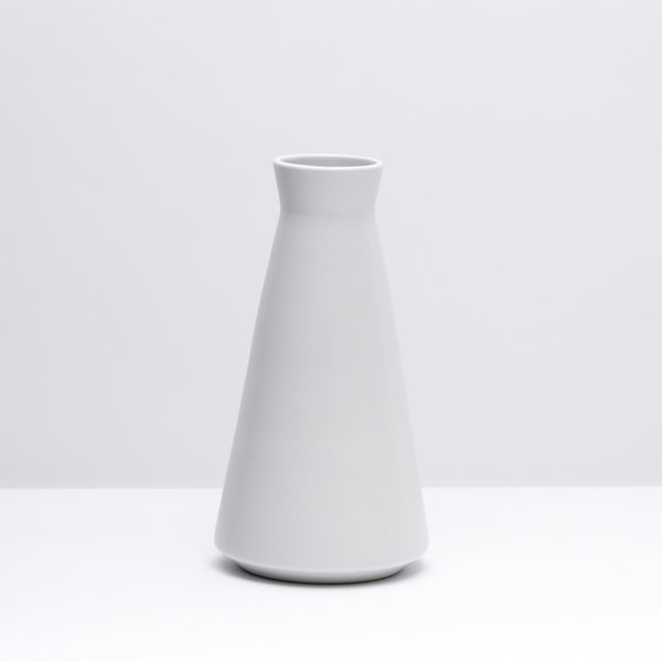 The porcelain decanter in salt, our mid-century inspired white glaze. Modern, handmade pottery, made in Detroit, Michigan.  USA Made ceramics and unique gifts. white pottery.