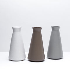 The porcelain wine decanter in various color options. Modern, handmade pottery, made in Detroit, Michigan.  USA Made pottery and unique gifts. Simple pottery.