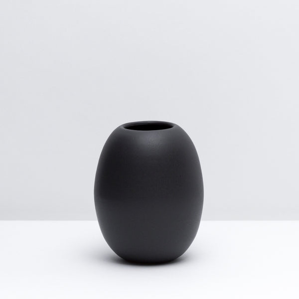 Hand-thrown Porcelain Bud Vase in Dusty Black, our modern black glaze. Modern, handmade pottery. USA made ceramics and unique gifts.