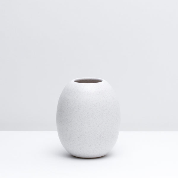 Hand-thrown Porcelain Bud Vase in Freckle, our modern white speckled glaze. Modern, handmade pottery. USA made ceramics and unique gifts.