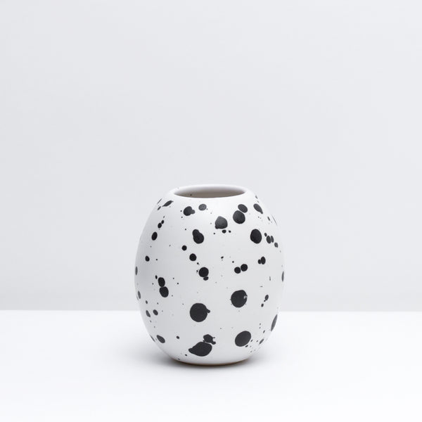 Hand-thrown Porcelain Bud Vase in Splash, our modern black and white glaze. Modern, handmade pottery. USA made ceramics and unique gifts.