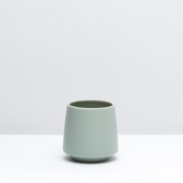 The porcelain wine cup in mint, our green glaze. Modern, handmade pottery, made in Detroit, Michigan.  USA Made ceramics and unique gifts.