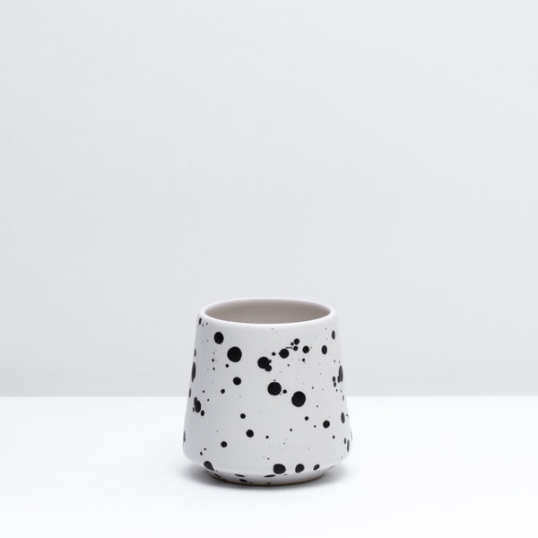 The porcelain wine cup in Splash, our black and white glaze. Modern, handmade pottery, made in Detroit, Michigan.  USA Made ceramics and unique gifts.
