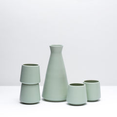 The porcelain wine set in mint, our green mid-century inspired glaze. Modern, handmade pottery, made in Detroit, Michigan.  USA Made ceramics and unique gifts. Green pottery.
