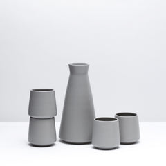 Porcelain Wine Set including four wine cups and one decanter in Pewter, our modern grey glaze. Modern, handmade pottery. USA made ceramics and unique gifts.