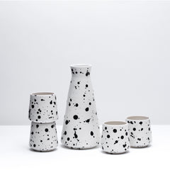 The porcelain wine set in Splash, our mid-century inspired black and white glaze. Modern, handmade pottery, made in Detroit, Michigan.  USA Made ceramics and unique gifts. Black and white pottery.