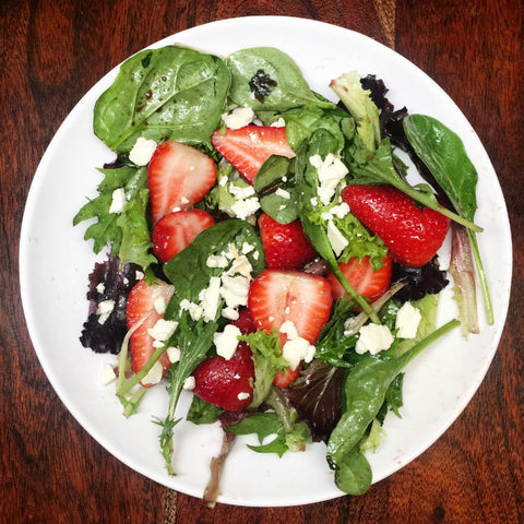 A plate of strawberry Salad seasoned with elderberry balsamic vinegar and olive oil