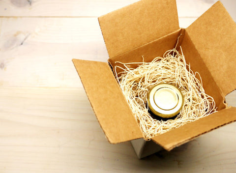 A small package box contains a 50ml bottle of olive oil sampler