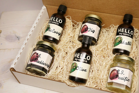 A opened gift box of six sampler bottles of California olive oil and balsamic vinegar