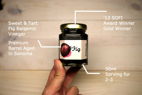 A hand holding a 50ml bottle of O Fig Balsamic Vinegar