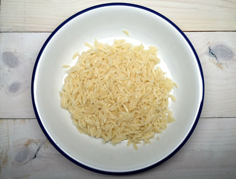 Putting Boiled Orzo Pasta in a Dish