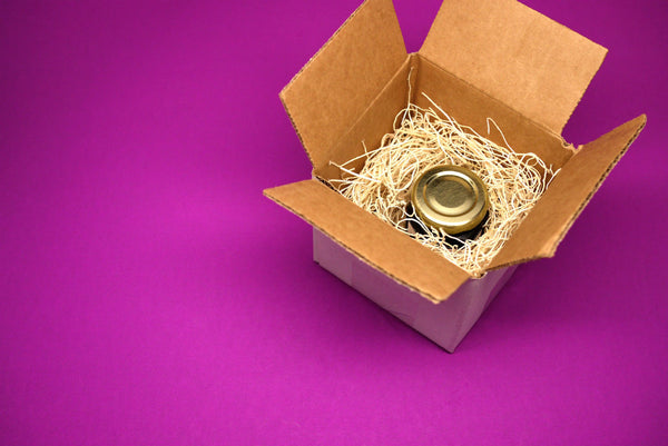 a small balsamic vinegar bottle in a package