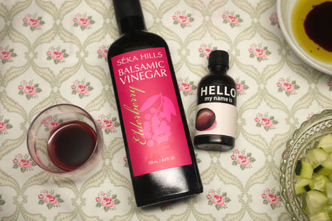 A 250ml bottle and a 50ml bottle of Seka Hills Elderberry Balsamic Vinegar placed on the table