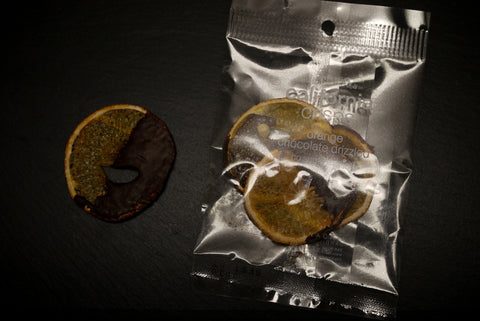 A pack of dehydrated orange slices dipped with dark chocolate