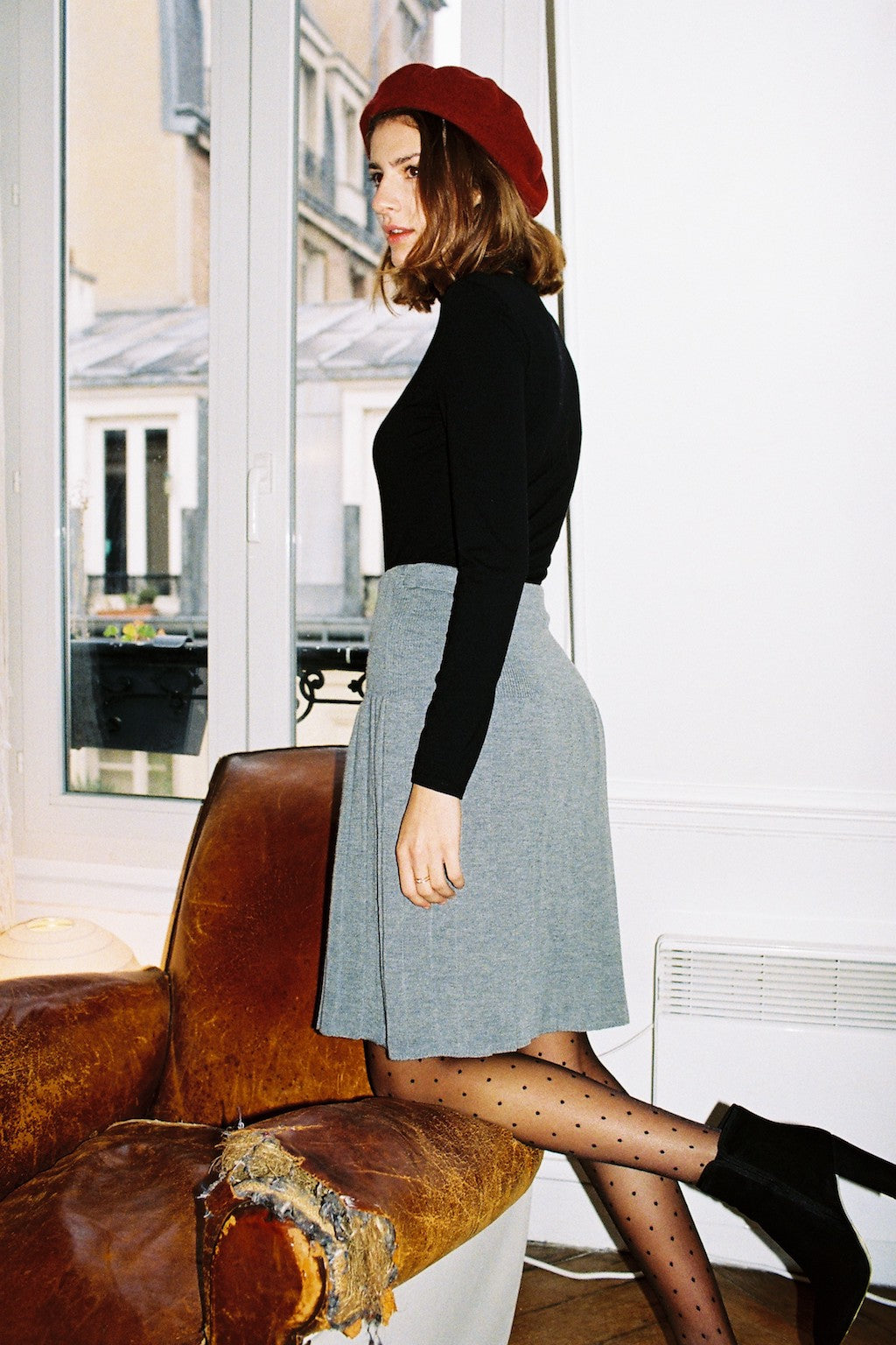 Style your beret with a turtleneck and skirt like at Les Sublimes