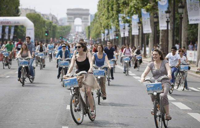 Girls biking along the Champs Elysees in Paris
