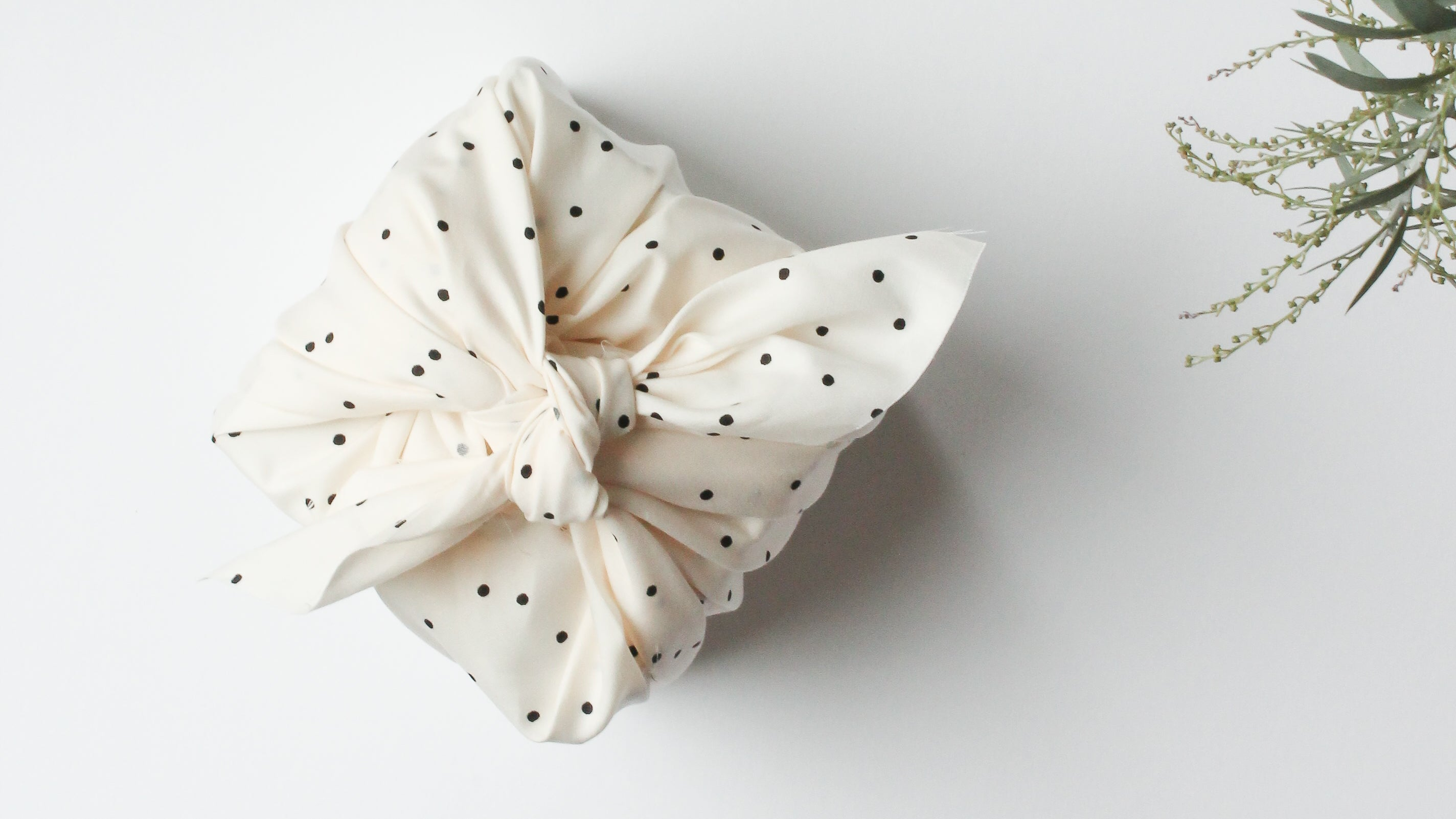 gift wrapped using a polka-dot scarf