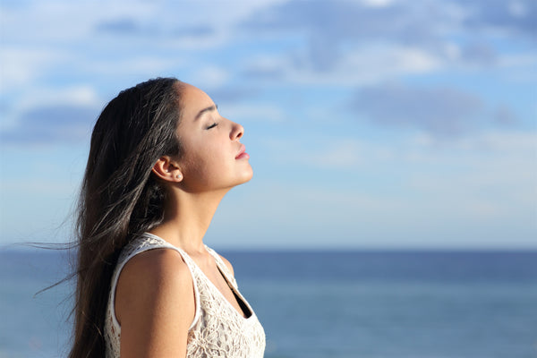 Girl breathing in the fresh air - the air in your lungs