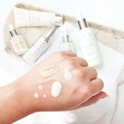A persons hand showing swatches of ARK Skincare's Sensitivity & Redness Collection