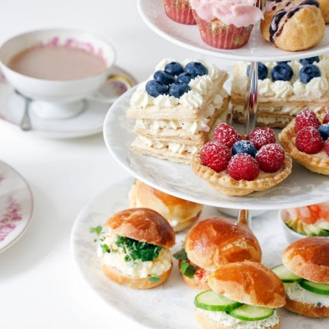 A selection of sandwiches, cakes and desserts for an afternoon tea