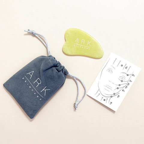 ARK Skincare's Jade tool with a grey pouch and how-to guide