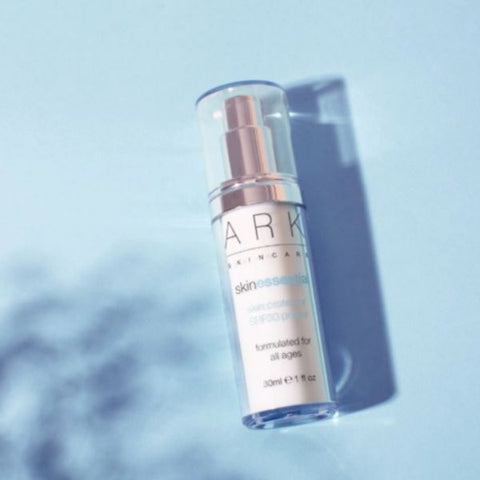 Product Image of ARK Skincare's Skin Protector SPF 30 Primer on a blue, sunlit background