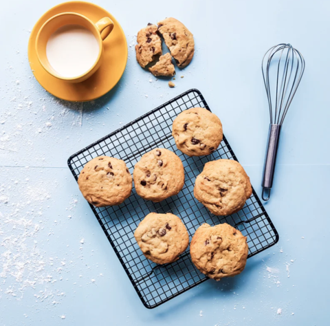 Image: Chocolate chip cookies on a cooling rack next to a mug of milk
