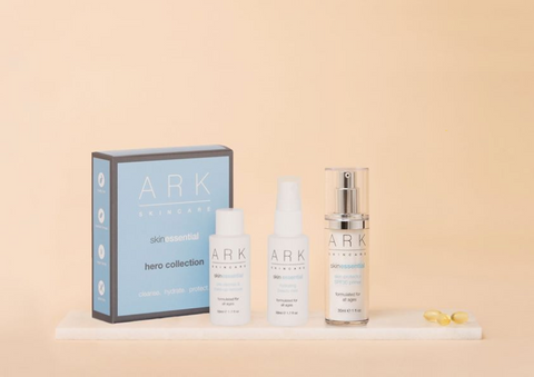 Product Image of ARK Skincare's Hero Collection box on a marble slate alongside 1 mini hydrating beauty mist, 1 mini pre-cleanse and makeup remove and 1 full size SPF.