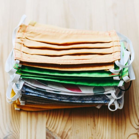 Image: Pile of different coloured reusable cotton face masks