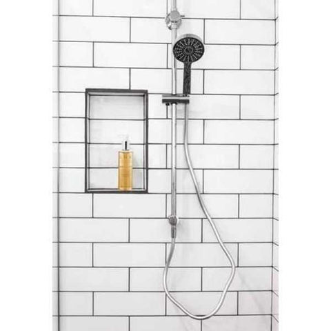Shower handle against a fresh white tiled bathroom wall.