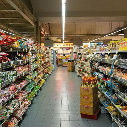 Shopping isle with lots of different brands of food