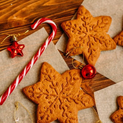 Freshly baked festive gingerbread snowflakes and candycanes