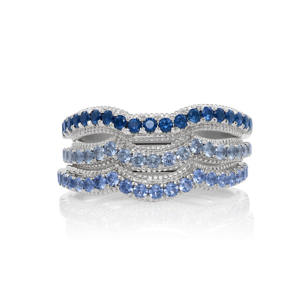 Scalloped Wide Band Ring in White Gold an Assortment of Blue Sapphires.