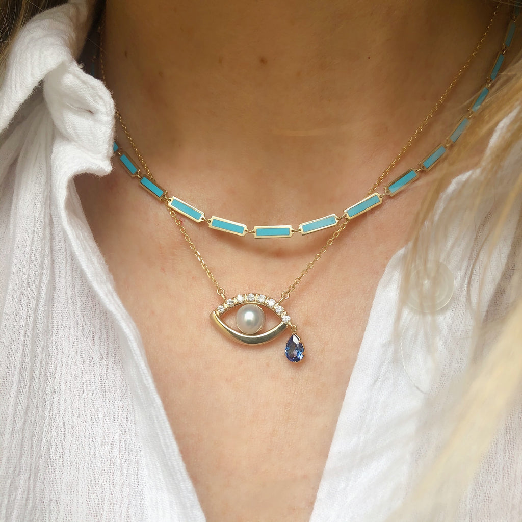 Turquoise Chain Necklace in Yellow Gold worn with eye charm necklace with yellow gold, pearl and sapphire