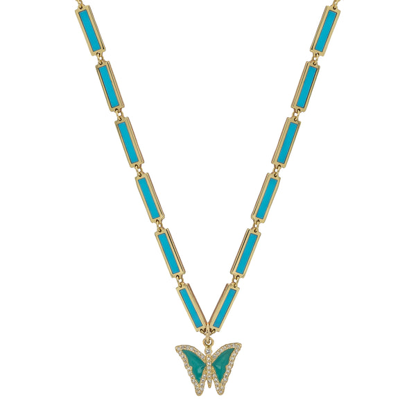 Turquoise chain necklace in yellow gold with a turquoise butterfly charm outlined with diamonds.