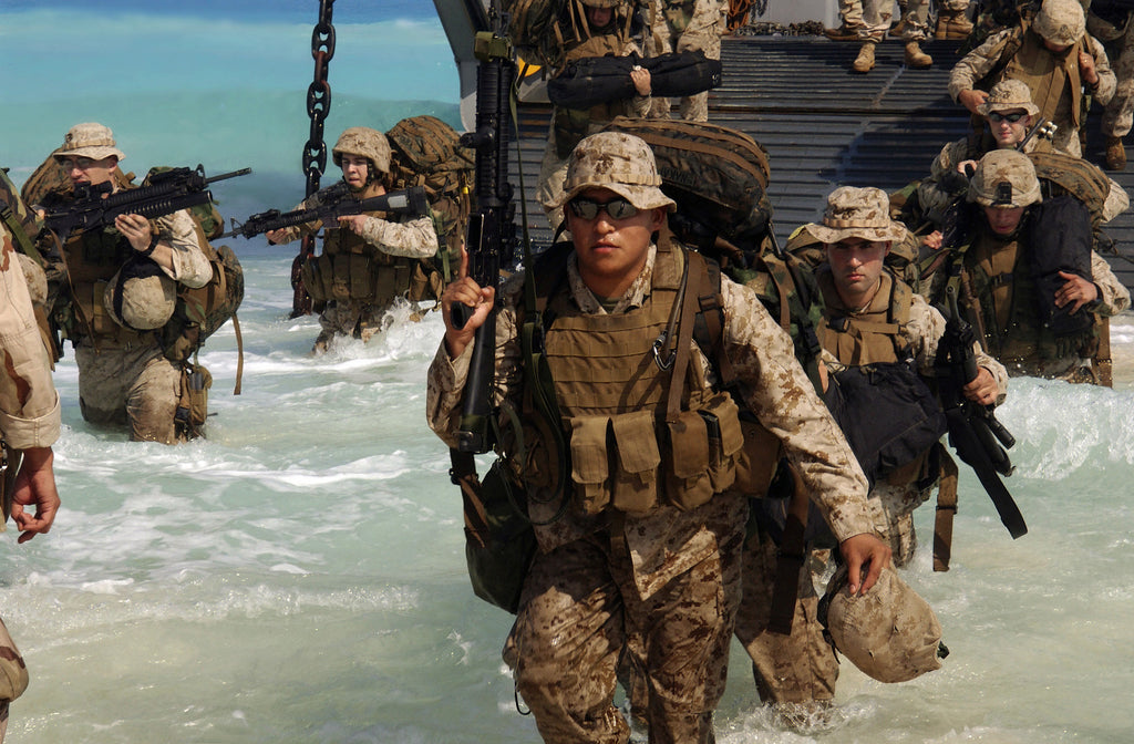 US Marine Corps (USMC) Marines from Expeditionary Strike Group 1 (ESG 1), 13th Marine Expeditionary Unit (MEU), disembark a US Navy (USN) landing craft utility (LCU) ship in preparation for an upcoming amphibious assault landing demonstration for Exercise BRIGHT STAR 05 in Mubarek Military City (MMC), Egypt.