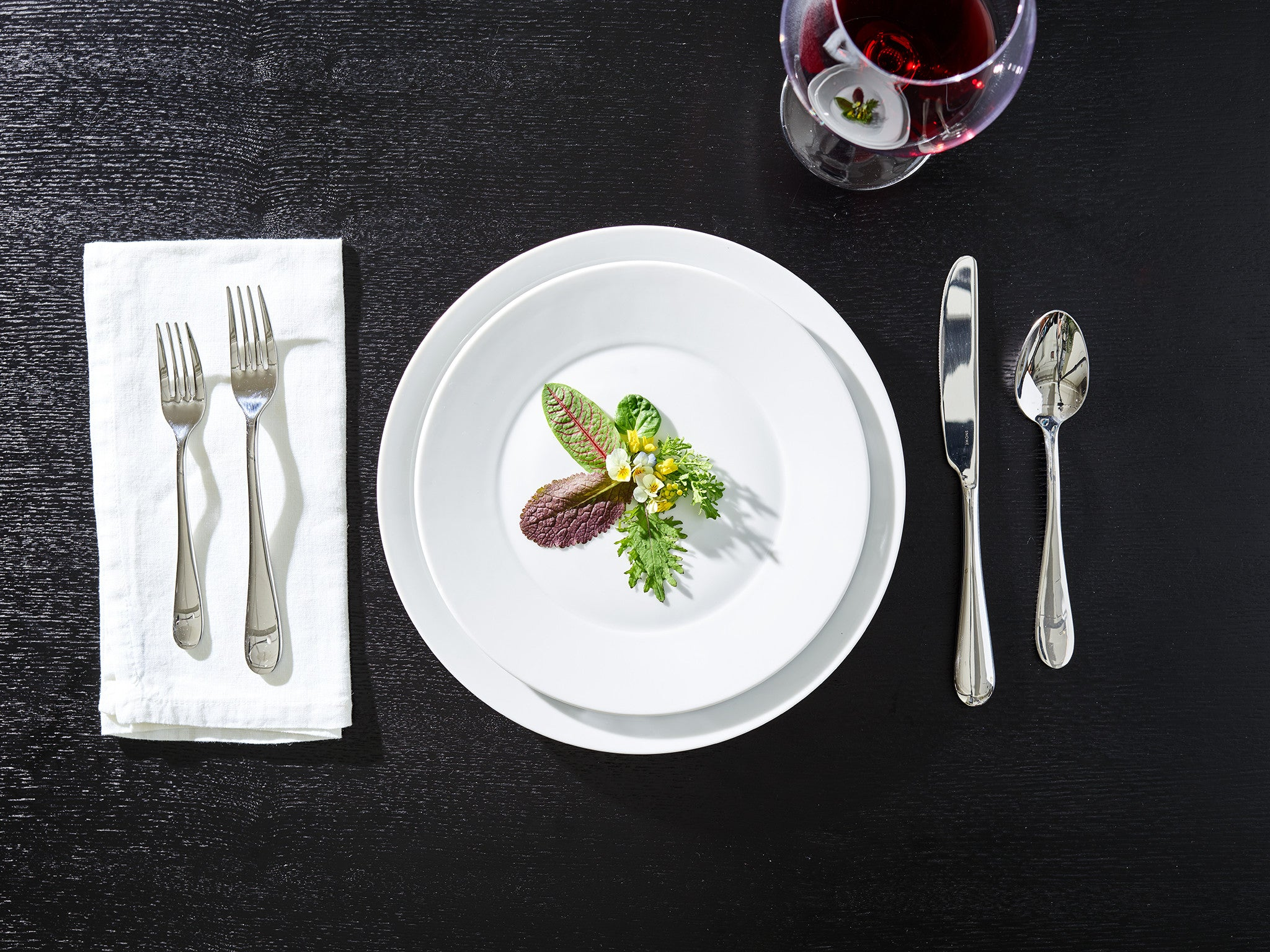 place setting featuring a contemporary salad