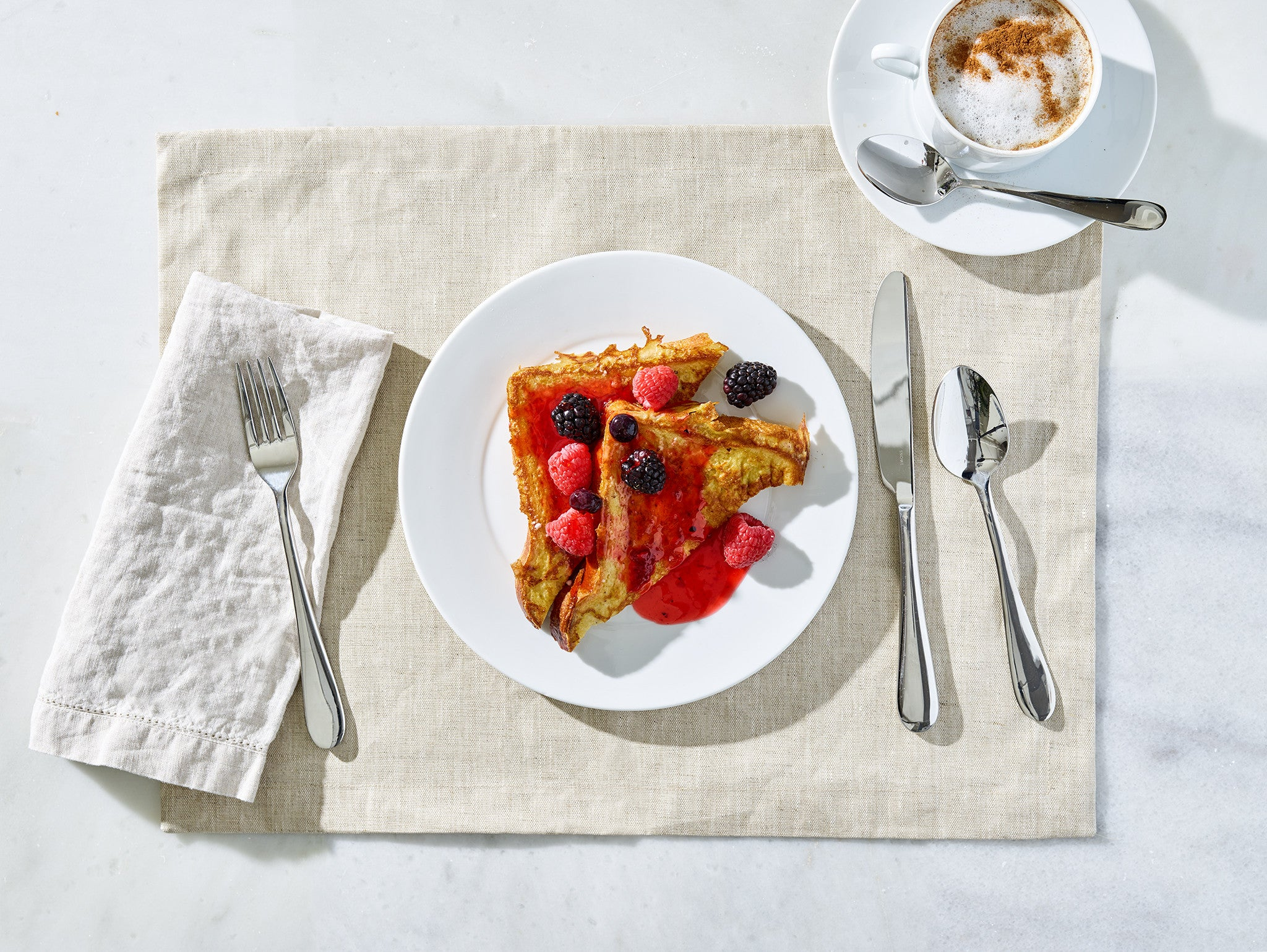 french toast with berries on a plate