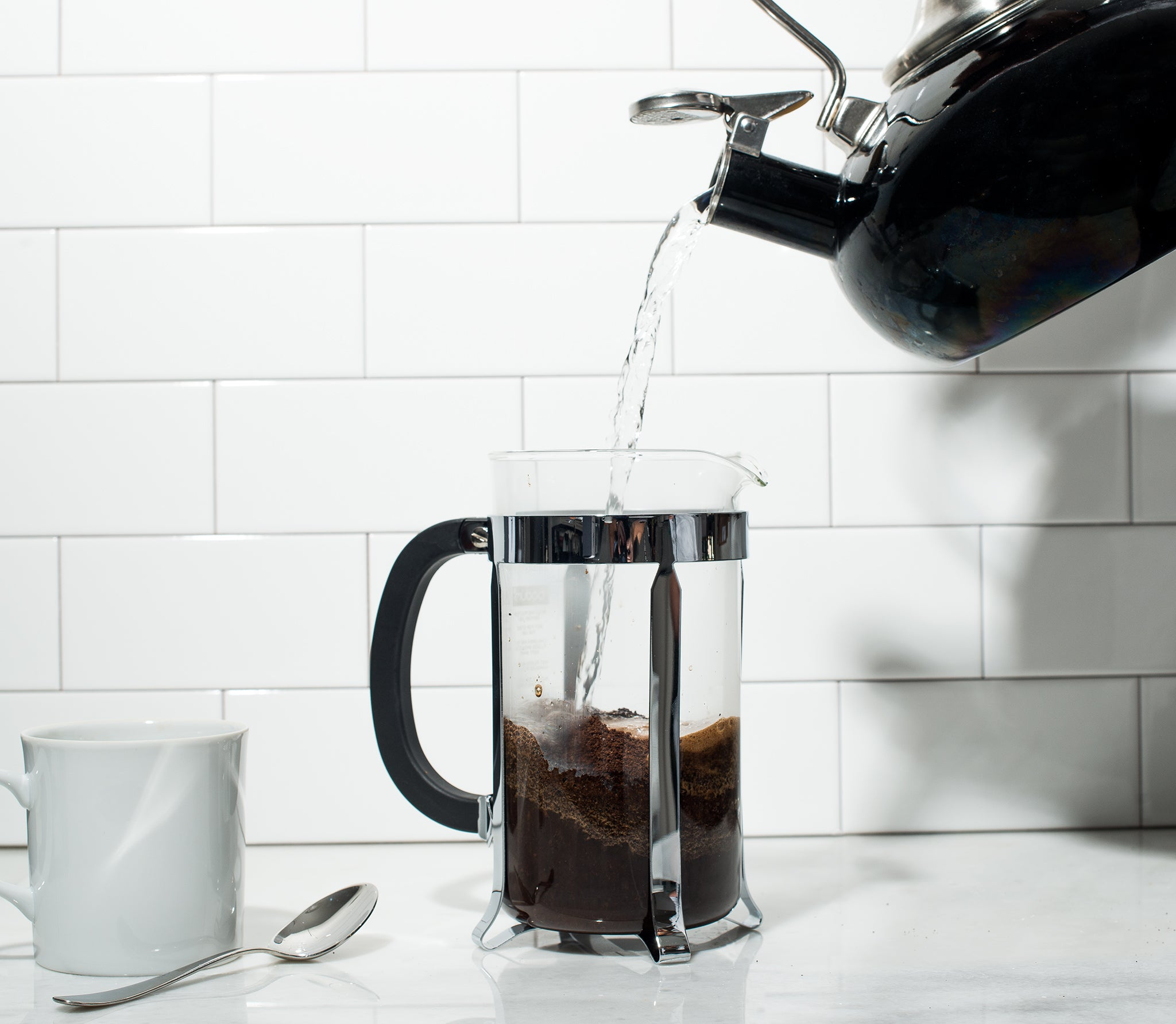 Pour water over the coffee grounds to saturate them first.