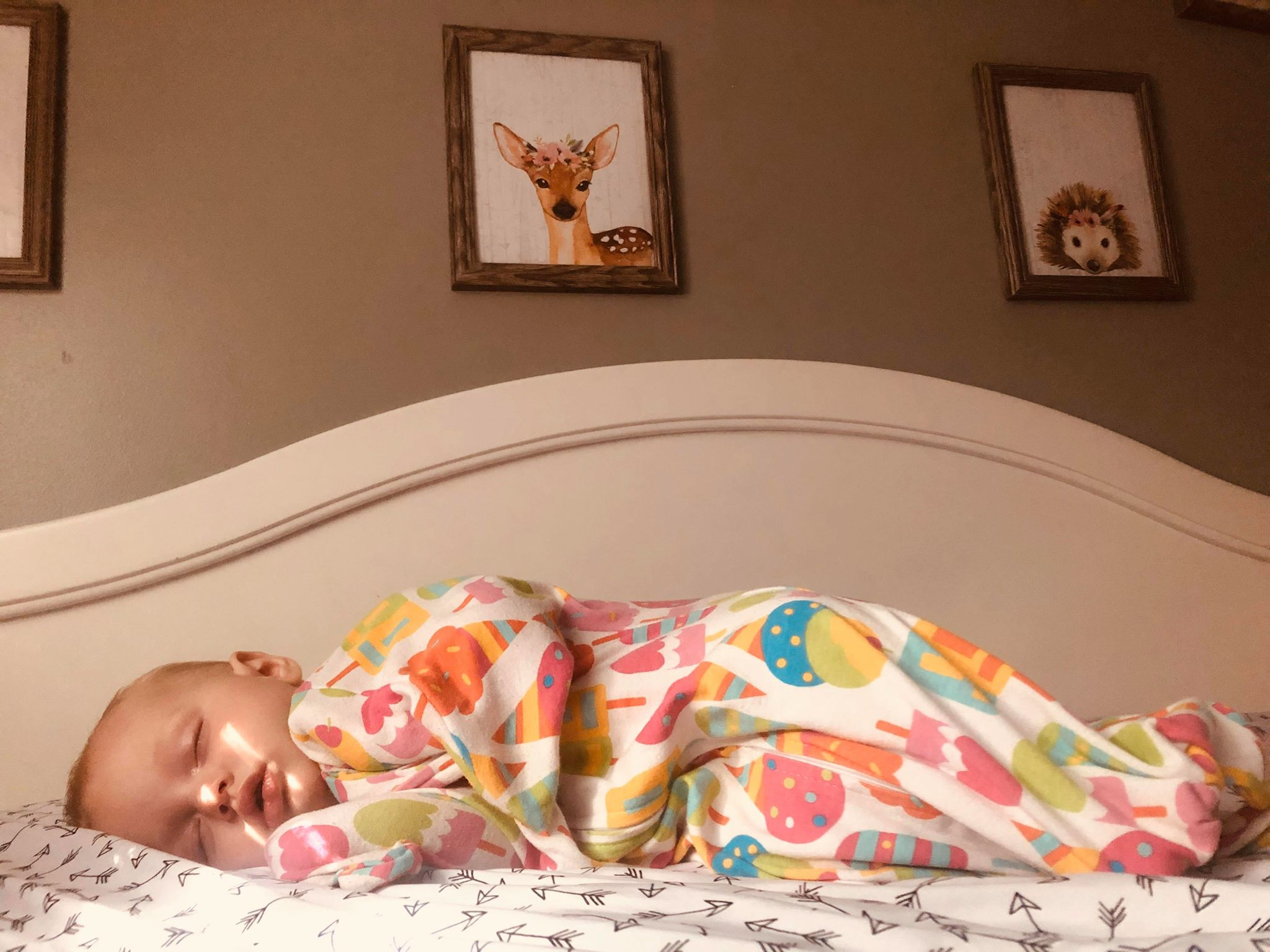 Baby rolling over from safe baby sleep positions