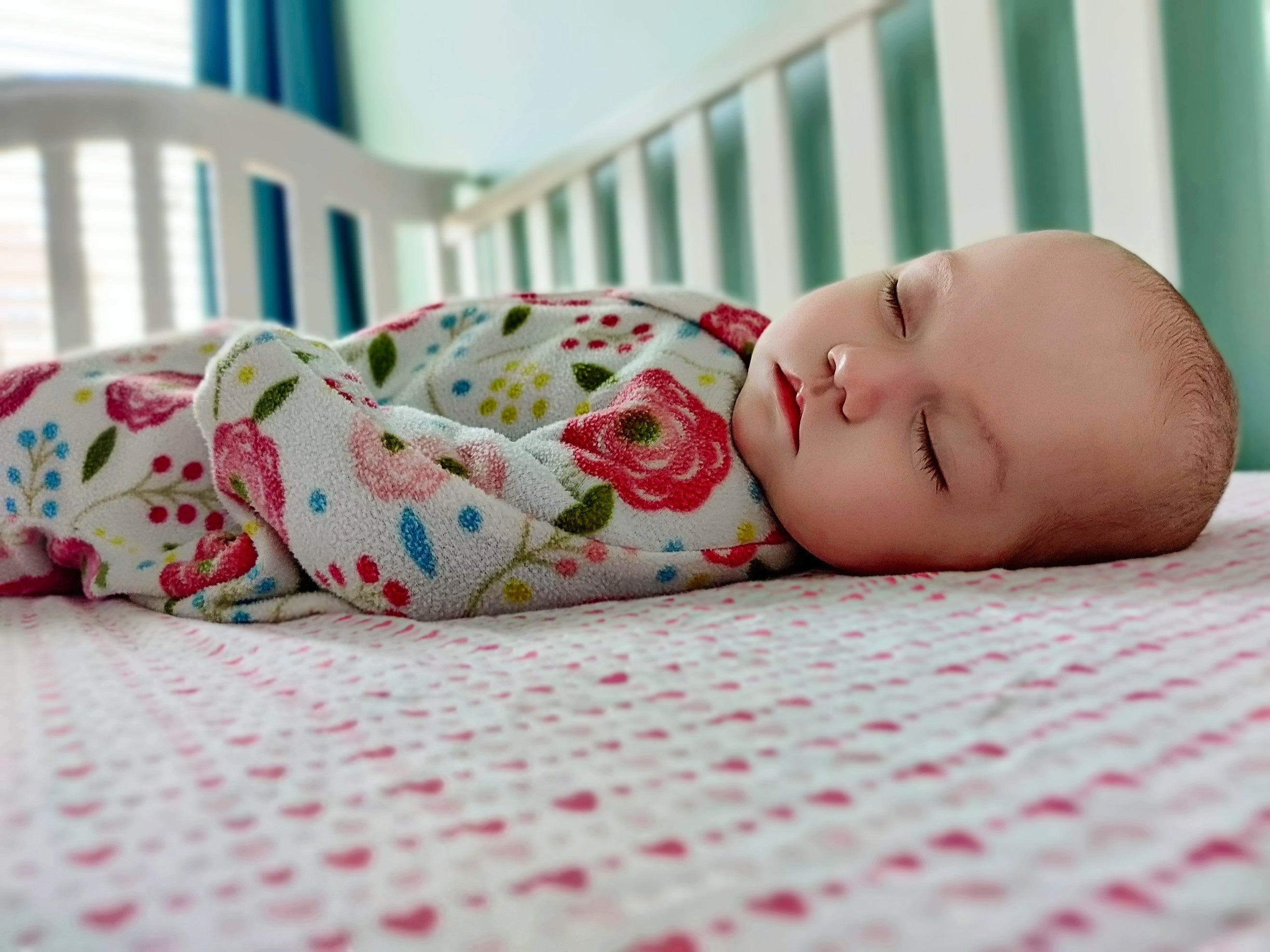 Baby sleeping in safe baby sleep position to reduce SIDS