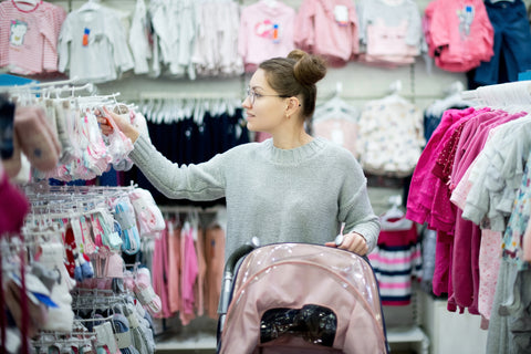 mother deciding what baby should wear to sleep