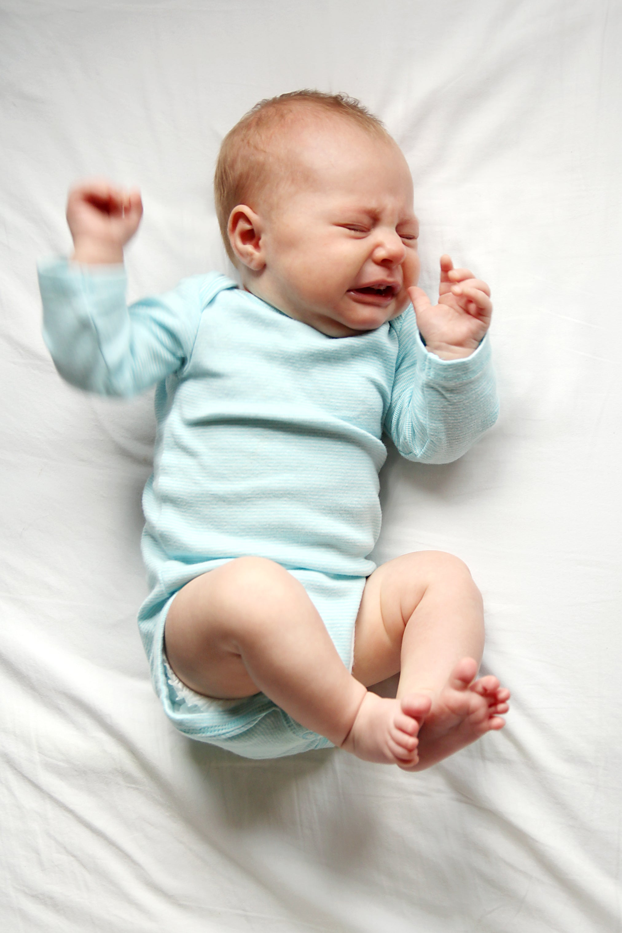Little baby crying and night in crib