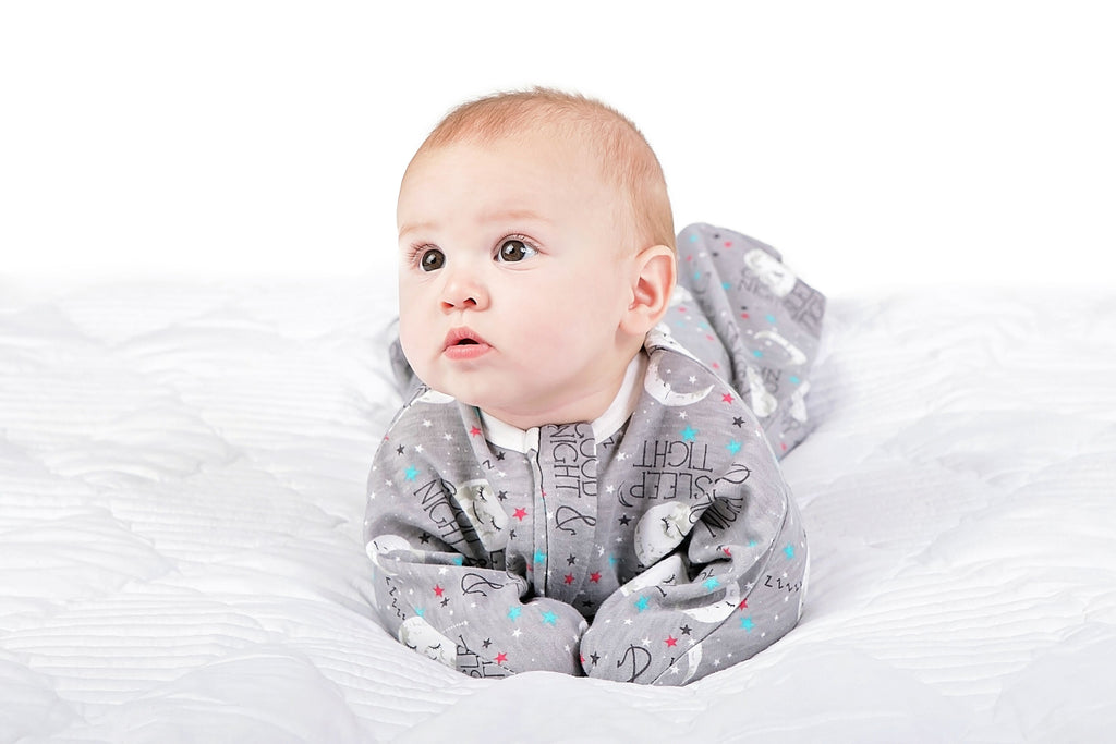 Infant wearing comfy sleeping clothes that are perfect for baby rolling over