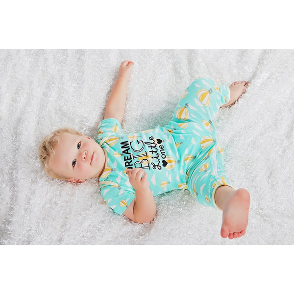 Baby one piece by sleeping baby