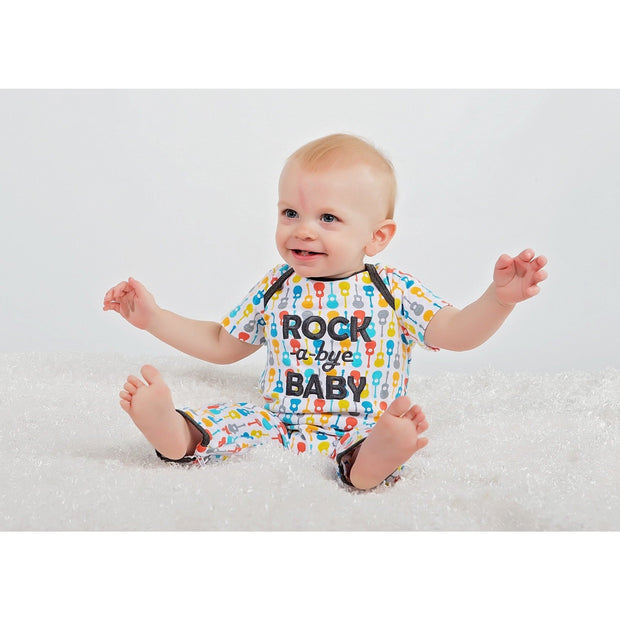 Baby boy in rocking baby zippyonez by sleeping baby