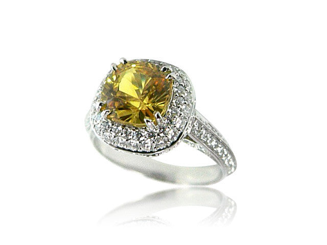 Vintage Halo Engagement Ring with a Cushion Cut Yellow Diamond San Diego